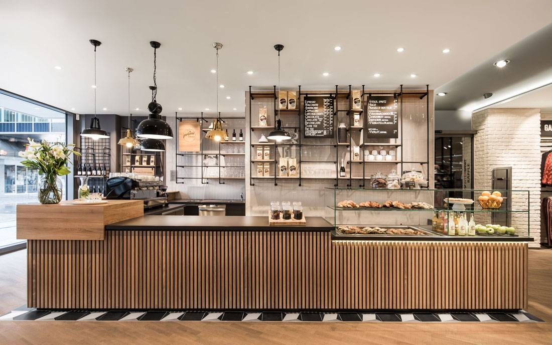 Golden accents in the lights take up the packaging design of the products and represent the exquisite coffee culture. The robust appearance of the ... & Primo Cafe Bar Tubingen - Attitude Interior Design Magazine