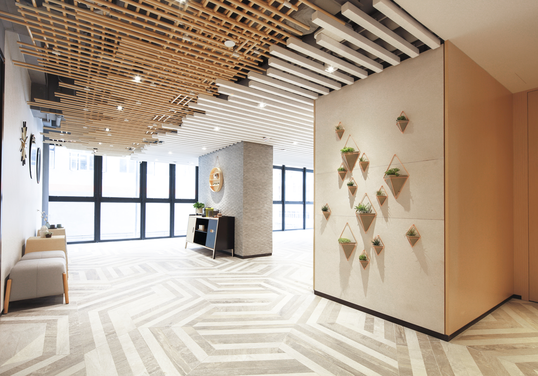 with a mixture of materials such as carpet and concrete juxtaposed with unique patterns around the decor enhances a modern and stylish hotel